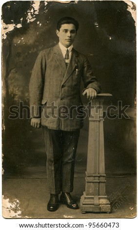 USSR - CIRCA 1928: growth portrait of a man in a business suit with a pen in his pocket, Elan, now Volgograd Region, Russia, USSR, 1928, Russian text on the stamp - the photographer Karpukhin, Elan