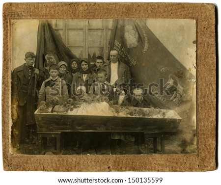 USSR - CIRCA May 23, 1935: Antique photo shows funeral, relatives stand near the coffin, USSR, May 23, 1935 - stock photo