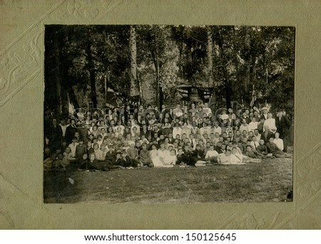 USSR - CIRCA May 1, 1932: Antique photo shows pupils and teachers of school, May 1, 1932 - stock photo