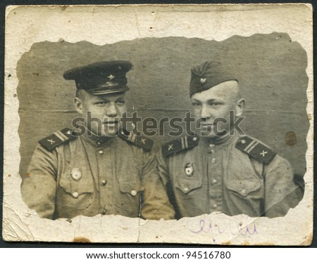 USSR - CIRCA 1945: Photo taken in the USSR, depicted two soldiers of the Red Army, circa 1945. The inscription on hands, the Russian name - Sergey. - stock photo