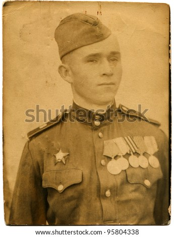 USSR - CIRCA 1944: Portrait of a Soviet Army soldier who was awarded the Order of the Red Star and five medals, Kirovograd, Ukraine, circa 1944 - stock photo