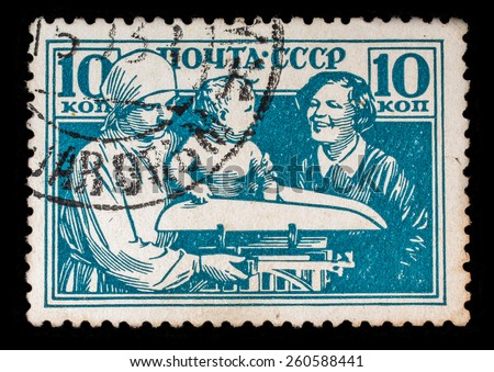 "USSR - CIRCA 1938. Postage stamp from the series ""Children of the USSR"". Motherhood and Childhood in the USSR - stock photo"