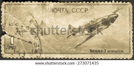 USSR - CIRCA 1945: Postage stamp showing the military battle aircraft Yakovlev-3. World War II. Circa 1945 - stock photo