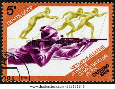 USSR - CIRCA 1984: Postage stamps printed in the USSR, shows the XIV Olympic Winter Games in Sarajevo, biathlon, circa 1984 - stock photo