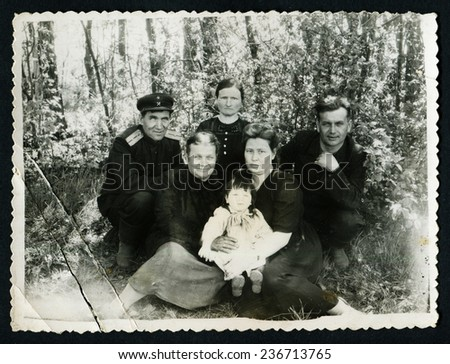 Ussr - CIRCA 1950s: An antique Black & White photo show family portrait in forest