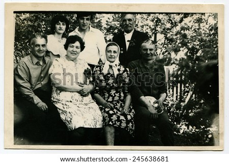 Ussr - CIRCA 1970s: An antique Black & White photo show family portrait in the garden