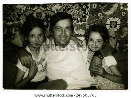 Ussr - CIRCA 1950s: An antique Black & White photo show father and two daughters - stock photo
