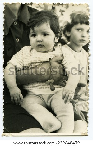 Ussr - CIRCA 1980s: An antique Black & White photo show little girl at the hands of his father - stock photo