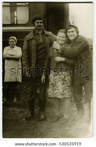Ussr - CIRCA 1960s: An antique Black & White photo show People stand near the railway wagon
