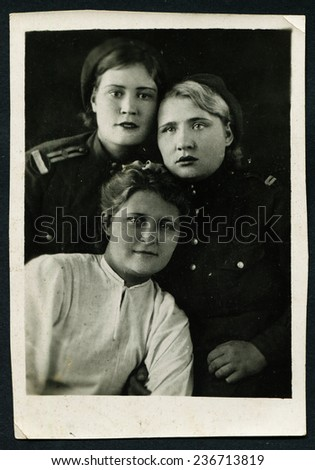 Ussr - CIRCA 1970s: An antique Black & White photo show portrait of three women during the Second World War - stock photo