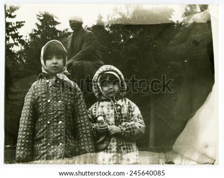 Ussr - CIRCA 1970s: An antique Black & White photo shows two girl - stock photo
