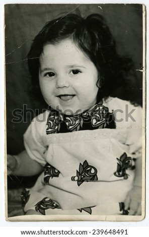USSR - CIRCA 1980s: An antique photo show little girl  - stock photo