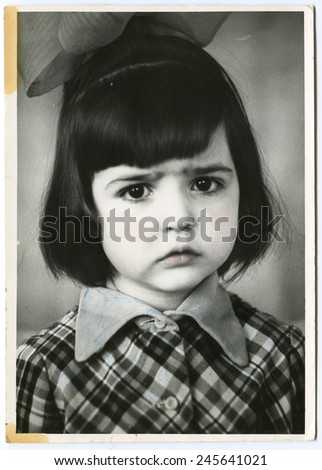 USSR - CIRCA 1980s: An antique photo show little girl with a bow on her head - stock photo