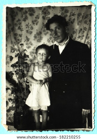USSR  - CIRCA 1930s: An antique photo shows father and daughter