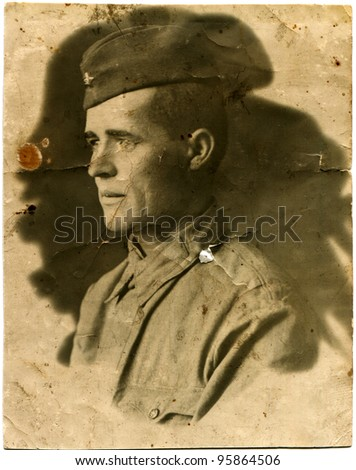 USSR - CIRCA 1930s: Portrait of a Red Army soldier in his cap, circa 1930s - stock photo