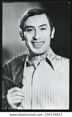 USSR - CIRCA 1960s: studio portrait of handsome man with a Hollywood smile, USSR, 1960s - stock photo