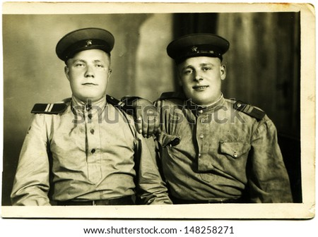 USSR - CIRCA 1960s: Vintage photo shows studio portrait of two junior sergeant of the Soviet Army, 1960s