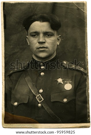 USSR - CIRCA1943: Soviet army captain, who was awarded the Order of the Red Star and a medal, circa May 10, 1943 - stock photo