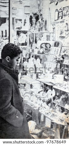 "USSR - CIRCA 1957: Soviet magazine ""Ogoniok"" shows photo of boy in the store in New York made by U. Gukov, publishing house ""Pravda"", issue 3, circa 1957 in Moscow, USSR - stock photo"