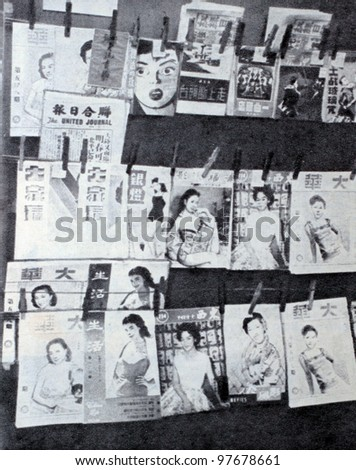 "USSR - CIRCA 1957: Soviet magazine ""Ogoniok"" shows photo of newsstand storefront in Chinatown in New York made by U. Gukov, publishing house ""Pravda"", issue 3, circa 1957 in Moscow, USSR - stock photo"