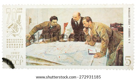 USSR - CIRCA 1987: Stamp printed in Russia shows Lenin planning strategy with two generals. 70th anniversary of the Russian revolution, circa 1987. - stock photo