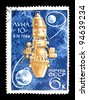 "USSR - CIRCA 1966: stamp printed in the USSR (Russia) shows a soviet spaceship Luna-10, earth, moon with inscription ""Luna-10, 3 IV 1966"", series ""Success of the USSR in space exploration"", circa 1966 - stock photo"