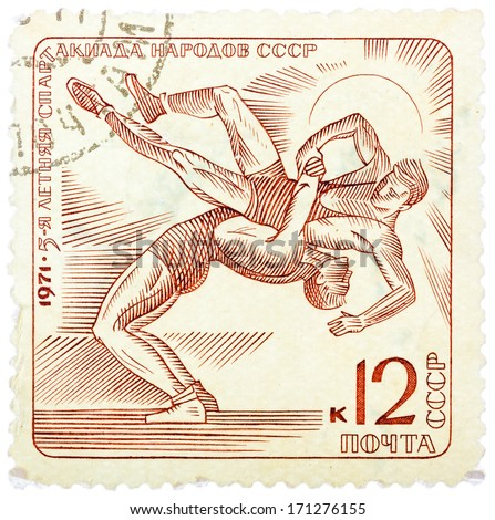 "USSR - CIRCA 1971: stamp printed in the USSR (Russia) shows Wrestling with the inscription and name of a series ""1971, 5 Summer Games of people of the USSR"", circa 1971 - stock photo"