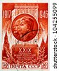 USSR - CIRCA 1946: stamp printed in USSR (now is Russia), XXIX anniversary of the Russian Revolutions with portrait of Joseph Stalin and Vladimir Lenin, circa 1946 - stock photo