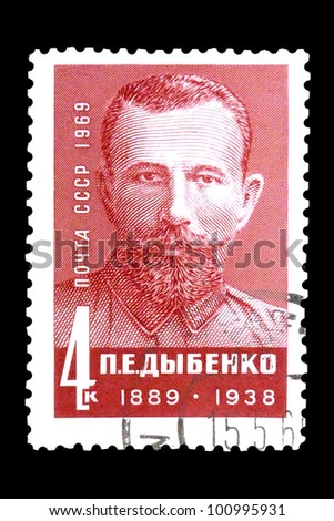 """USSR - CIRCA 1969: stamp printed in USSR shows portrait of Dybenko - Russian military statesman with the inscription """"P. E. Dybenko (1889-1938)"""", series """"80th Birth Anniversary of Dybenko"""", circa 1969 - stock photo"""