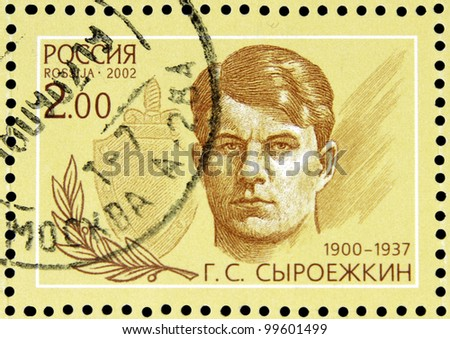 """USSR - CIRCA 2002: stamp printed in USSR shows portrait of Syroezhkin (1900-1937) with inscription in block """"Outstanding agents 1922 - 1937"""",  series 80 years of Soviet secret service, circa 2002 - stock photo"""