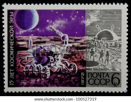 USSR - CIRCA 1972 : stamp printed in USSR, 15 years of space age, spacecraft explores surface of moon, circa 1972 - stock photo