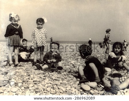 USSR, Russia, - CIRCA 1948: An antique black & white photo of children on beach.