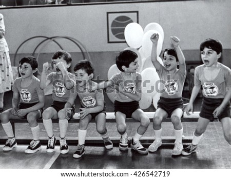 USSR, Russia - CIRCA 1978: An antique Black & White photo  of sportrs competition for children, boys waiting on a bench.