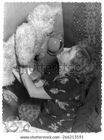 USSR, Russia, - CIRCA 1972s: An antique Black & White photo of a young woman with teddy bear. - stock photo