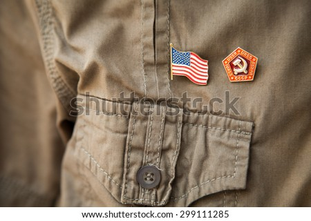 USSR & USA flag, national emblem on a khaki shirt: Stars and stripes, hammer and sickle - stock photo