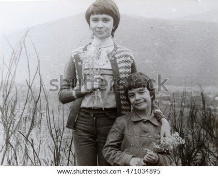 USSR, WESTERN UKRAINE, TRANSCARPATHIA - CIRCA 1982: Vintage photo of sister and brother amid the beauty of Transcarpathia
