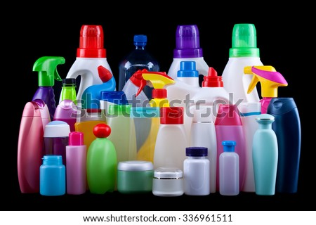 Usual plastic bottles from a household isolated on black - pollution and environment concept - stock photo