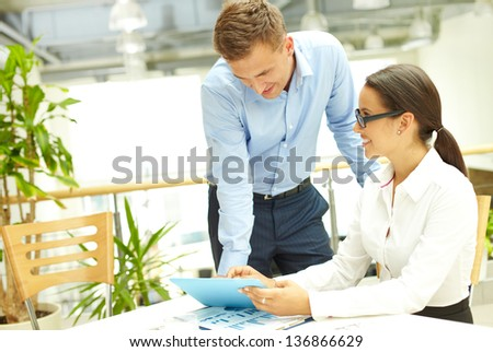 Usual working day at business agency, boss checking the work of his subordinate - stock photo