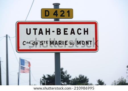 Utah Beach sign, the place where the allied liberators landed in WW2, French and US flags on Utah beach, Normandy, France - stock photo