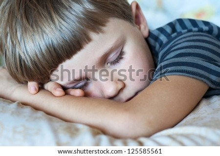 ute baby boy sleeping in his bedroom - stock photo