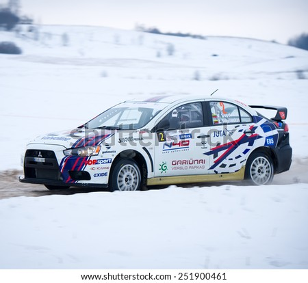 "UTENA - JANUARY 30: Mitsubishi Lancer Evolution X rally car during ""Halls Winter Rally 2015"", on January 30, 2015 in Utena, Lithuania. The Mitsubishi Lancer Evolution is a high performance sports car."