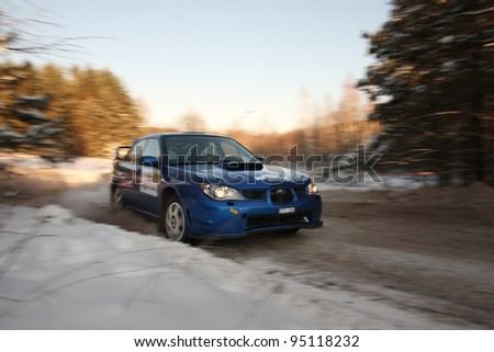 "UTENA, LITHUANIA - JANUARY 28: SAMSONAS MOTORSPORT team Subaru Impreza car during ""Halls Winter Rally 2012"", on January 28, 2012 in Utena, Lithuania"