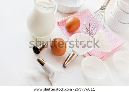 Utensils and ingredients for cream on white  - stock photo