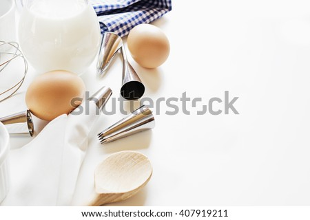 Utensils and ingredients for decoration of cake on white table with free text copy space. - stock photo