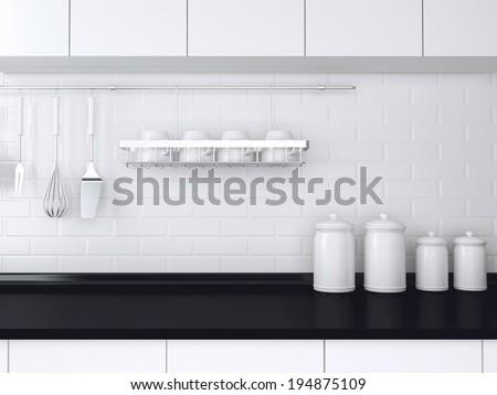 Utensils and kitchenware on the worktop. Black and white kitchen design. - stock photo