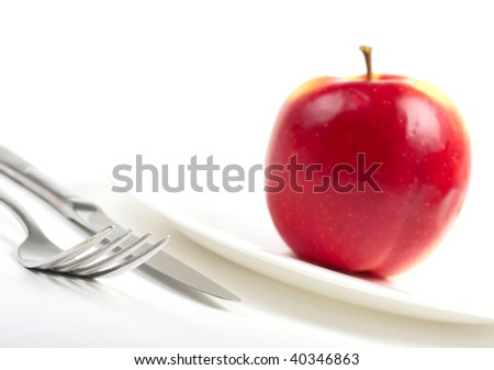 Utensils and red apple - stock photo