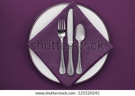 Utensils on a table napkin at the top view image - stock photo
