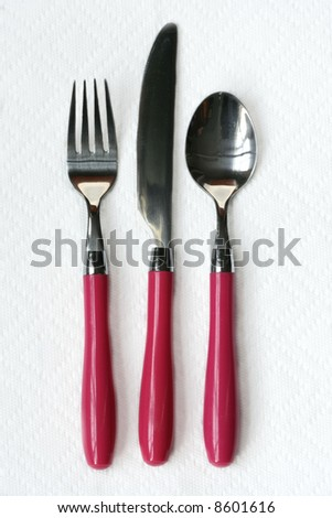 Utensils with Pink Handles - stock photo