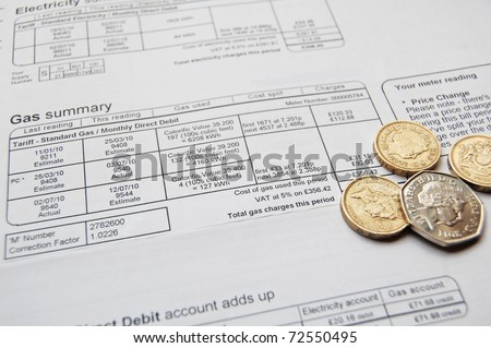utility bill and coins for payment - stock photo