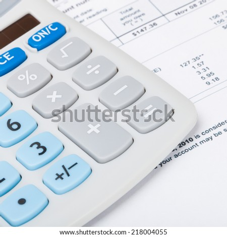Utility bill with calculator - 1 to 1 ratio - stock photo